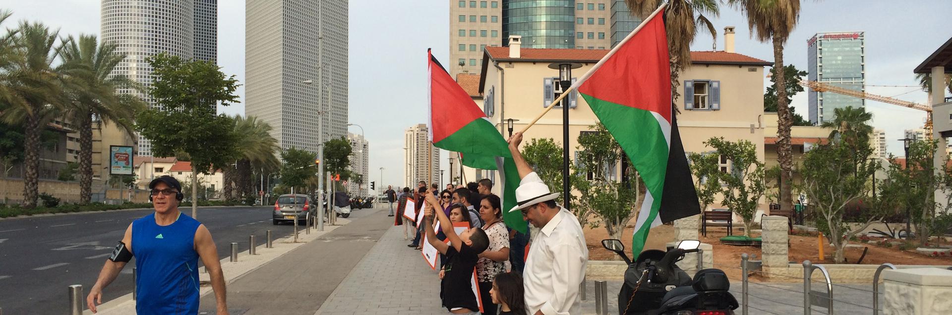 Palestinian protesting in Tel Aviv